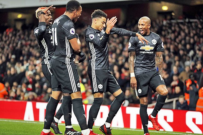 Anthony Martial, Paul Pogba, Ashley Young and Jesse Lingard, celebrate after scoring his side's second goal during the English Premier League match between Arsenal and Manchester United at the Emirates stadium