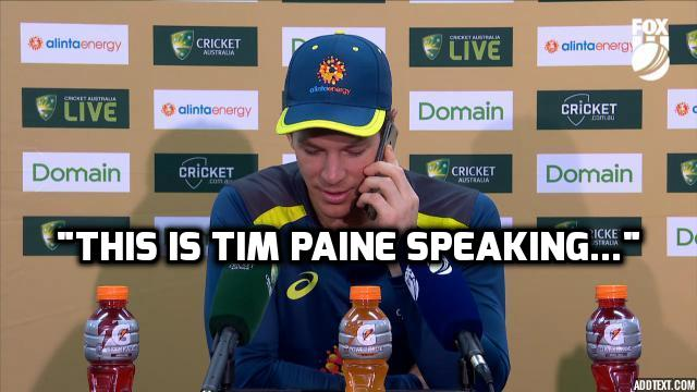 Tim Paine answers reporter's phone during presser