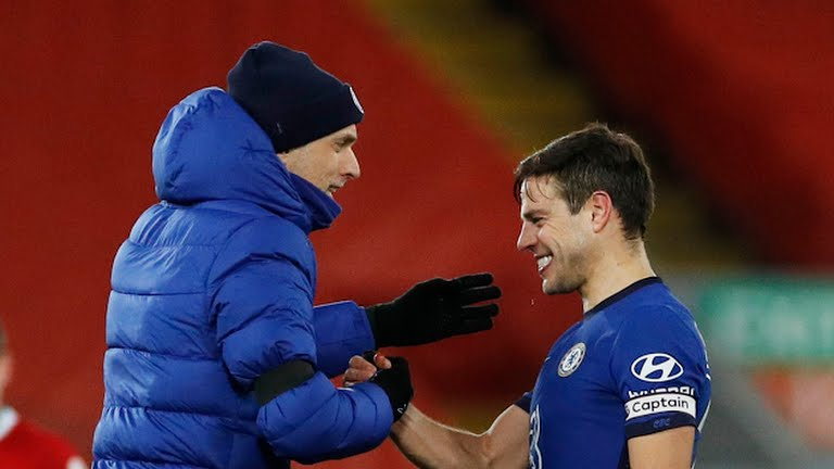 Chelsea manager Thomas Tuchel celebrates with Azpilicueta after victory over Liverpool